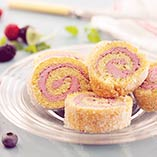 Swiss roll with meringue butter cream and wild berries