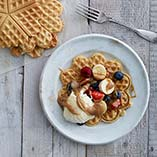 Waffles with salted caramel, banana and berries