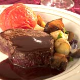 Fillet of beef with baked tomatoes and chocolate sauce