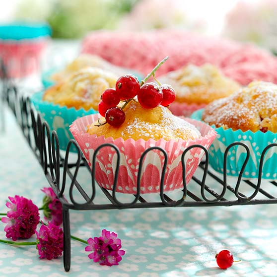 Fruit or berry muffins with marzipan