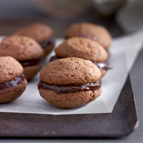 Chocolate whoopies with orange filling