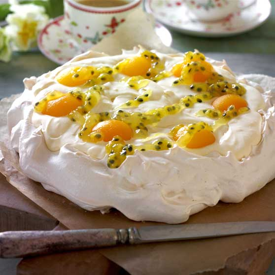 Easter Pavlova with lemon cream and passion fruit sauce