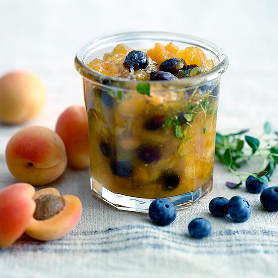 Apricot jam with blueberries and thyme