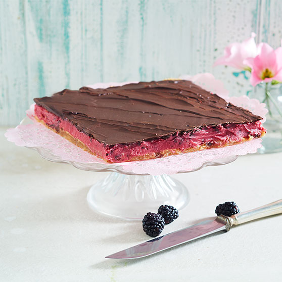 Summer cake with blackberry cream and chocolate
